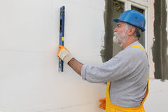 House renovation, polystyrene wall insulation, level tool Stock Photography