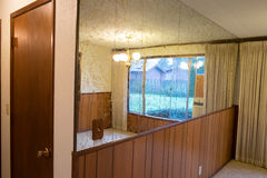 House Renovation and Remodel. Mirrored tile wall looks very outdated with gold flake and wood paneling at a house remodel Royalty Free Stock Photography
