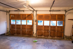 House Renovation and Remodel. Old damaged garage doors at a house renovation Royalty Free Stock Photo