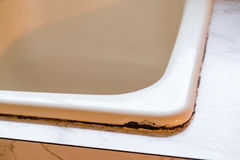 House Renovation and Remodel. Porcelain coated cast iron sink shows signs of damage at a house remodel and renovation Stock Photo