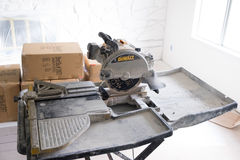 House Renovation and Remodel. SPRINGFIELD, OR - JANUARY 20, 2017: DeWalt tile saw setup and ready to cut during a DIY house remodel and renovation project Stock Photography