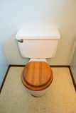 House Renovation and Remodel. Toilette with a wooden seat at a house remodel Stock Photography