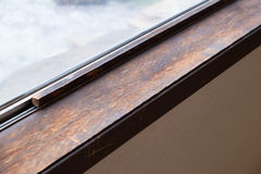 House Renovation and Remodel. Weather damaged window sill shows signs of being old at a house reonvation Stock Photo