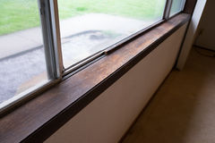 House Renovation and Remodel. Weather damaged window sill shows signs of being old at a house reonvation Royalty Free Stock Photos