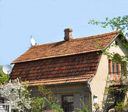 House renovation with roofing old ceramic tiles. Close up on roofing with old ceramic tiles Stock Image