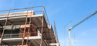 House for renovation with the scaffolding for bricklayers Royalty Free Stock Image