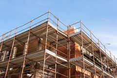House for renovation with the scaffolding for bricklayers Stock Image