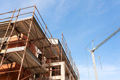 House for renovation with the scaffolding for bricklayers Royalty Free Stock Photos