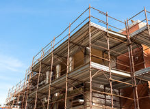 House for renovation with the scaffolding for bricklayers Royalty Free Stock Photography