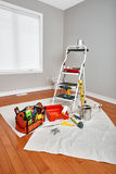 House renovation. Stepladder and painting tools in modern room. Apartment renovation background Royalty Free Stock Photos