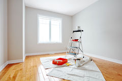 House renovation. Stepladder and painting tools in modern room. Apartment renovation background Royalty Free Stock Photo