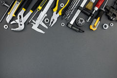 House renovation tools and accessories on dark grey background Royalty Free Stock Photo