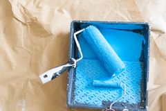 House renovation tools. In blue paint on brown craft paper stock photo