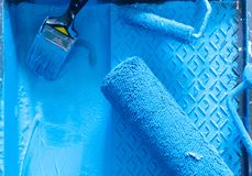 House renovation tools. In blue paint close up stock photography