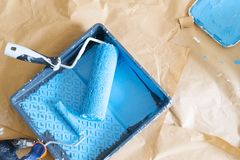 House renovation tools. Colored in blue paint on brown craft paper royalty free stock image