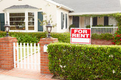 House for rent. Front of house with for rent sign royalty free stock photos
