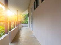 House rent. Concrete walkway to room inside flowers garden on morning day stock photo