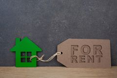 House for rent label. On wooden background royalty free stock images