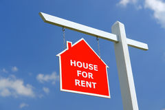 House for Rent signpost. White wooden post with red House for Rent notice board over blue sky Stock Photography