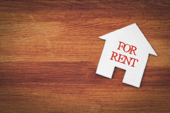 House for rent symbol on wood Stock Images