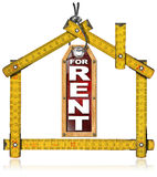 House For Rent - Wood Meter Tool. Wooden yellow meter tool forming a house and hanging tag with written for rent royalty free illustration