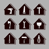 Vector icons set with construction tools for repair or alteration of the house on a gray background Stock Photos