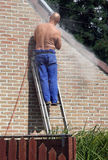House Repair Man At Work Stock Photography