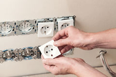 House repairing. Repairing electricity in house- changing power socket Stock Photo