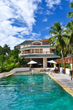 House  resort with a swimming pool Stock Photos