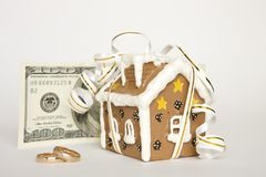 House with ribbon, money, wedding rings Royalty Free Stock Images