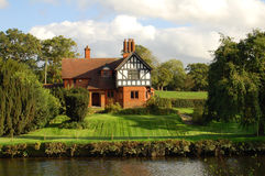 House by the River. A scenic house overlooking the river with well maintained gardens Stock Photography