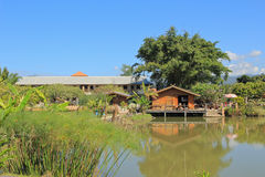 House on the river. Red house among trees and along a river, shot in Thailand Stock Image