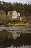 The house on the river bank Royalty Free Stock Images