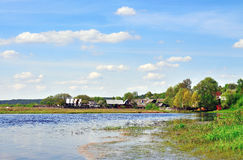 House on the river bank. Beautiful view of the river Royalty Free Stock Photos