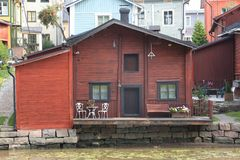 House on the river bank. House with a terrace on the river bank Stock Images