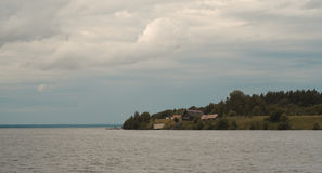 House on the river. Cloudy. Russian North. House on the river. Cloudy Royalty Free Stock Photography