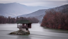 A house on the river Drina in Serbia. A house built on a rock in the middle of river Drina in Western Serbia Royalty Free Stock Images