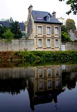House by the river in France. A house with strong reflections by the river in France Stock Images