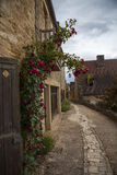 House and road with flowers in Beynac France Stock Photography