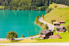 House with road on the Lake Lungern. Idyllic segment of the famous Lake Lungern in Switzerland Stock Photo