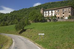 House with road sign to Denuy Spain in the Pyrenees Mountains, Province of Huesca, Spain Royalty Free Stock Photography