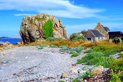 House and a rock on atlantic beach, Brittany, France Stock Image
