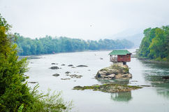 House on rock on river. Wooden house on Drina River in Serbia royalty free stock photography