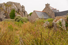 House between rocks in Brittany, France Royalty Free Stock Photos