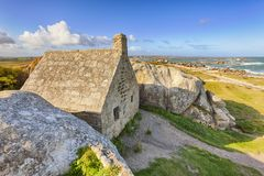 Ancient customs house between rocks at Meneham, Brittany royalty free stock images