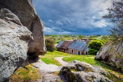 House between the rocks in Meneham village, Kerlouan, Finistere, Brittany (Bretagne), France royalty free stock photography