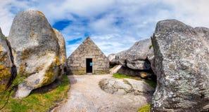 House between the rocks in Meneham village, Kerlouan, Finistere,. Brittany (Bretagne), France Royalty Free Stock Image