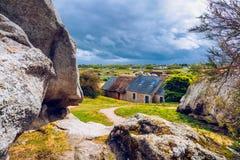House between the rocks in Meneham village, Kerlouan, Finistere,. Brittany (Bretagne), France Stock Photography