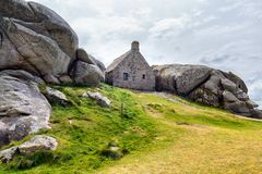 House between the rocks in Meneham village, Kerlouan, Finistere,. Brittany (Bretagne), France Royalty Free Stock Photography