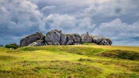 House between the rocks in Meneham village, Kerlouan, Finistere, Brittany (Bretagne), France royalty free stock image